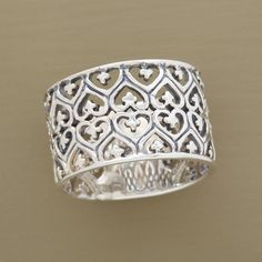 """FILIGREE HEARTS BAND--Hidden within this lacy oxidized sterling silver heart filigree band are multiple hearts that whisper of your love. Handcrafted exclusively for Sundance. Whole sizes 5 to 10. 1/2""""W. This ring runs a bit small, if you wear a half size you should size up to the next full size."""