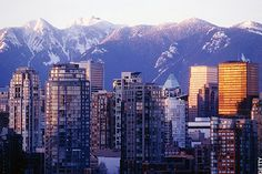 A beautiful mountain backdrop with downtown Vancouver in the foreground.