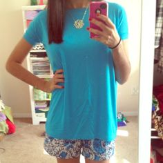 Authentic Piko (Short sleeve, kids, teal) Ripped the tags off but never wore it. It's a kids Medium but fits me and I wear a 00/XXS/XS (although it's not as loose as the piko style usually intends). Made of bamboo so it is super soft and comfortable (I own  6 pikos because I love them so much). Piko Shirts & Tops Tees - Short Sleeve