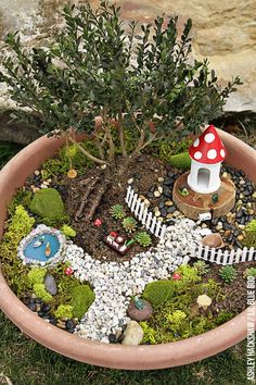 Fairy Garden Ideas - How to make a Bonsai Tree Fairy Garden - How to make a DIY fairy garden for small spaces using a container, garland lights and moss. MichaelsMakers Lil Blue Boo
