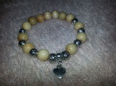 Zuzana Saki/ wooden beads with silver heart
