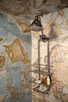 """My husband found a box of old National Geographic maps, so I collaged the maps on the bathroom wall,"" Ms. Heckman said. Matthew Millman for The New York Times"