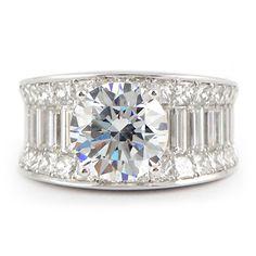 3.5 ct. 32 princess cut diamonds and 14 baguette diamonds 18k white gold mounting
