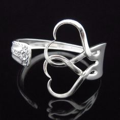 Fork Bracelet, Eco Friendly Recycled Silverware Jewelry in Intertwining Hearts Design Number Two. $29,99, via Etsy.