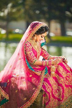 Beautiful indian bride in pink lehenga
