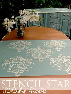 Dining room set was painted by Stiltskin Studio with Chalk Paint™ and our Small Ribbon Damask stencil on the leaves.