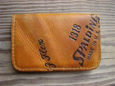 Single Fold Old Baseball Glove Wallet with two interior pocket that hold folded bills, cards, etc.