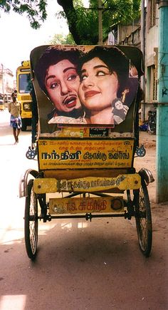 Tamil film star of yesteryears, MGR, on the back of a trishaw with the current Chief Minister of Tamil Nadu, India who was then an actress.