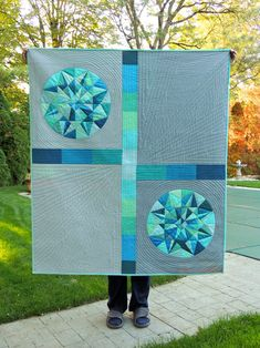 Gemstone Quilt: Finished! I am pleased to report that I finished the gemstone quilt this weekend! I'm happy with how it's turned out. I learned a few new sewing/quilting skills along the way - foundation paper piecing and curved piecing - that I know...