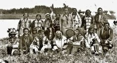 Cree and Saulteaux group on the File Hills Reserve in Saskatchewan - 1914 *Standing in back L-R: Pimotch or Mrs. Keewaydin (Cree), Kunayopasweays or Mrs. Jack Fisher (Cree), Piobskokamik or Mrs. Bear Floor (Cree), Kikakaykiswayo or Mrs. Buffalo Bow (Cree), Keeseekowpimotah or Day Walker (Cree), Iskwaysis or Mrs. Yellow Belly (Cree), Witawpaytuk or Mrs. Pimotat (Cree), Sakowsyquayo or Mrs. Playful Child (Cree) *Sitting in front L-R: Okimowk-kikile or Chief Hawk (Cree), Pinoway-moostoos or…