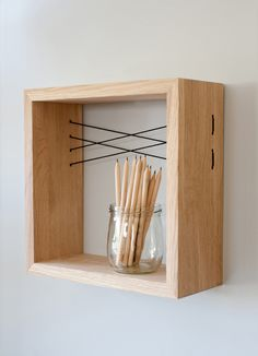 Multi-use decorative shelf made from solid oak wood. Application of threads in double-x pattern.