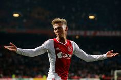 Viktor Fischer Photos Photos - Viktor Fischer of Ajax celebrates with the fans after victory in the Eredivisie match between Ajax Amsterdam and PSV Eindhoven at Amsterdam Arena on December 1, 2012 in Amsterdam, Netherlands. - Ajax Amsterdam v PSV Eindhoven - Eredivisie