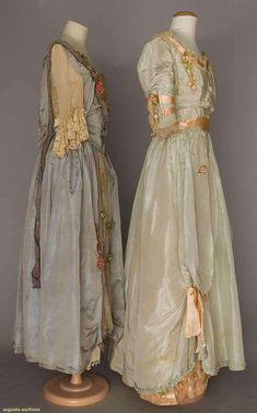 "2 silk taffeta party dresses, geneva & n.y., 1916-1920s 1 ""George Bernard, New York"" in steel blue w/ floral lame ribbon & lace; 1 ""Melle Chabloz, Geneva"" in pale blue w/ pink ribbon & ribbon flower trims"