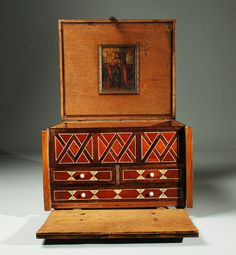 A superb 17th century Spanish colonial fruitwood 'escribania' with finely crafted mahogany, cedar and bone marquetry inlay, hand etched sgraffito and original hand forged iron hinges, hasp and lock-plate, all backed with original red felt. The lidded top with original 17th century hand painted oil on copper painting of 'San Luis Rey'. Finished on all sides with four finely crafted interior drawers and original bun feet. Overall, a colonial masterpiece of the highest caliber.