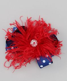 A bit of bedazzle, frilly finesse and a pop of patriotic pattern are the sugar and spice that make this set so nice. This stretchy headband comes with a bold bow that can be worn together or sweetly separate. Includes bow and headbandRecommended for newborns to six yearsSatin / ostrich feather / acrylic