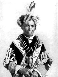 Odjib'we, Frances Densmore's informant on ogichidaag (ceremonial headman ?) customs, attired in his ogichidaag regalia; Photo by Francis Densmore, 1908