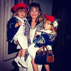 Mary Kate and Ashley with their mom, Jarnie, at City Hall with the cast of Full House, c. 1993