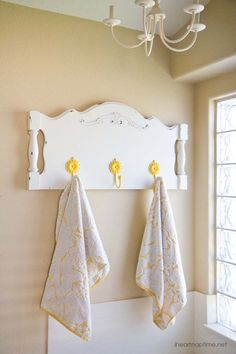 Old headboard turned into a towel holder.
