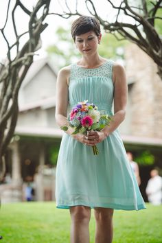 Mint bridesmaid dress with colourful bouquet