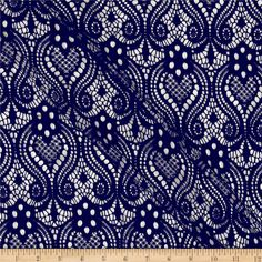This lightweight lace fabric has a soft hand and a 20% stretch across the grain for added comfort and ease. Add a touch of elegance with this beautiful lace fabric.