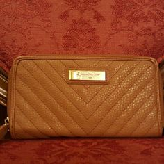 Jessica Simpson Zipped Wallet/Billfold Classic and versatile means you'll actually use this wallet! Jessica Simpson has done it again. This wallet Billfold features 2 zippers, plenty of space for cards, id holder, coin zipper compartment, and can fit your phone if you rather not use a purse/wristlet. Perfect condition! Jessica Simpson Bags Wallets