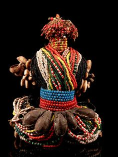 Africa | Fertility doll from the Fali people of Cameroon | wood, glass beads, shells, leather, seed pods