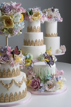 All kinds of pretty in this photo! These wedding cakes are perfect for a spring wedding! We love the pastel colors and butterflies. Cake Artist: Elizabeth Solaru