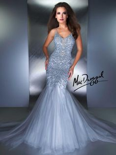 Sparkling stones dance across the bodice of the gown followed by pouring crystals. Cascading layers make up the mermaid skirt for this perfect couture gown. Great prom dress cross over too. Multiple layers of tulle creates a beautifully voluminous mermaid skirt while the satin lining helps to illuminate the bodices intricate bead and rhinestone design.