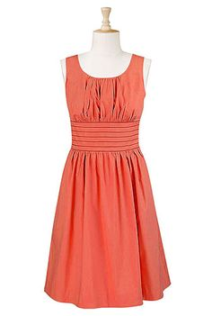 Such a cute dress.  Would be so nice to wear during the summer both to work with a cardigan and also to summer events.