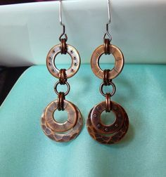 "These fun ""go with everything"" earrings are fabricated using copper washers. I texture them, stamp them, patina them and then assemble. When worn they are just under 2 inches long. Copper Earrings, Copper Jewelry, Wire Jewelry, Jewelry Crafts, Jewelry Art, Beaded Jewelry, Jewelry Design, Jewelry Ideas, Coin Jewelry"