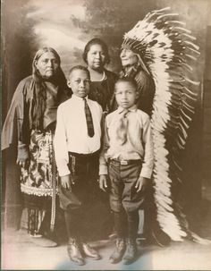 """This early 1900s photo of a Comanche family who share African-American heritage is from the exhibit """"IndiVisible: African-Native American Lives in the Americas."""" This traveling exhibition from the Smithsonian Institution is presented from noon-6 p.m. Monday through Friday through Jan. 31 in the Duderstadt Center Gallery. Photo by Sam DeVenney.