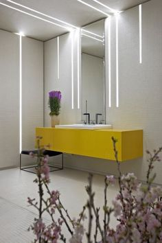 AMAZING lighting; like the off-the-floor yellow vanity, too.