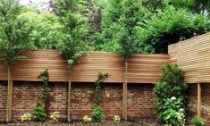 Hardwood slatted screening and half brick wall. And lollipop trees…! Garden Privacy, Backyard Privacy, Backyard Fences, Garden Fencing, Farm Fence, Pool Fence, Brick Fence, Concrete Fence, Cedar Fence
