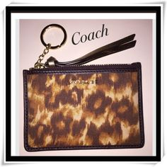 "Coach Madison ID Skinny Mini Wallet NWOTS Coach Madison ID Skinny Mini Wallet NWOTS. Ocelot print fabric with brown leather trim. Gold ""COACH"" metallic tag on front. Back has two slip pockets. One of them with a clear window for ID. A longer slip pocket behind the two. Zippered opening with leather pull. Inside is lined with brown satin fabric. Key fob attached inside. Coach Bags Wallets"