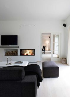 #fireplace woodstorage and tv on one wall