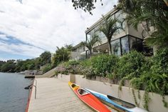 Beautiful, modern double storey home situated on the banks of the Nahoon River. The slipway and jetty will provide for hours of fun on the water