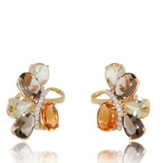 Fancy design earrings with alternating smoky Quartz( 2.5 ct) and lemon Quartz (2.3 ct) are separated from Citrine (1.3 ct) are separated by a band of Diamond (0.07 ct). Yellow Gold Earrings.