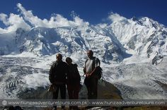 Rakaposhi (7788m) is one of the most beautiful peak and the world's 29th highest mountain. It dominates the horizon and watches over the Karakoram Highway as you travel from Gilgit to Hunza. The peak is surrounded by famous glaciers and valleys like Bagrot, Minapin and Jaglot. Karakoram Highway, Trek, Mount Everest, Traveling By Yourself, Most Beautiful, Base, Camping, Mountains, Watches