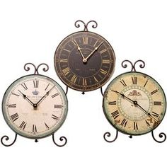"Add cottage-chic appeal to your mantel, countertop, or credenza with these beautifully-weathered table clocks.Product: 3 Table clocksConstruction Material: MetalColor: Ivory, green and brownFeatures: DistressedDimensions: 13"" H x 6"" W"