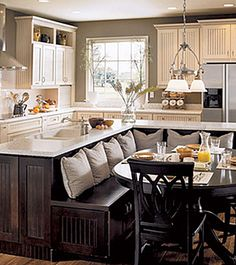 Kitchen with built-in seating area , L-shaped island. Love, love, love!