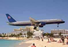 Planes landing at the Princess Juliana Airport, St. Maarten - United Airlines.