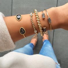 arm stacks \\ black + gold #bracelets #gold #cuffs
