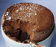 Chocolate Soufflé with Blood Orange Sauce (with tutorial video) - The deep, rich chocolate flavor in this individual soufflé comes from a combination of Dutch-processed cocoa powder and unsweetened chocolate in the pastry cream. The blood-orange sauce provides a sweet-tart counterpoint to the chocolate's richness, but if you prefer, you can pair soufflés with raspberry compote or ginger crème anglaise instead.  * #dessert #pastry #soufflé #french