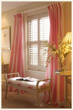 plantation shutters with drapes.  cute as a finishing touch or gilding the lily?  not sure.