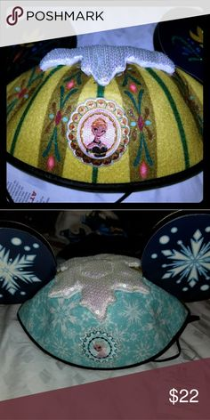 Frozen Reversible Anna & Elsa Ears Hat hat has Anna's coronation dress motif on 1 side while Elsa has the snowy motif on other. Can be worn either way. Disney Accessories Hats