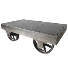 Industrial Coffee Table Cart   USA   1920's-30's   The best steel industrial coffee table cart with riveted top, brass manufactures tag to one edge sitting on steel spoked wheels.Brass tag states-Pangborn Corporation Hagerstown MD.USA