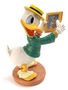 """WDCC Disney Classics Mr Duck Steps Out Donald Duck With Love From Daisy #WDCCDisneyClassics #Art. Donald's Jacket: Two firings make it plaid. Daisy's Photo: A miniature replica of the original including the message """"With Love From Daisy.""""  Anniversary Backstamp: 'Donald's 60th Birthday' appears on all pieces produced in 1994. Retired 06/96"""