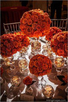 Burnt orange roses on glass vases - love this colour!