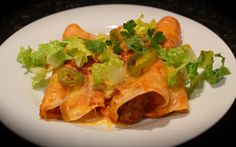 BEEF ENCHILADAS (Cook's Country)  3 garlic cloves, minced  3 T chili powder  2 t ground coriander  2 t ground cumin  1 t sugar  Salt  1 1/4 lb top blade steaks, trimmed  1 T vegetable oil  2 medium onions, chopped  1 (15-oz) can tomato sauce  1/2 cup water  2 cups shredded Monterey Jack cheese or mild cheddar cheese  1/3 cup chopped fresh cilantro leaves  1/4 cup chopped pickled jalapeño chiles  12 (6-inch) corn tortillas