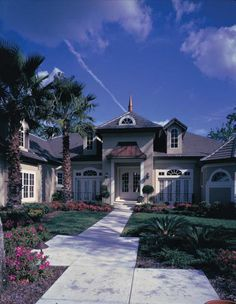 Peaked roofs and charming dormers make this Southwestern house truly delightful.   House Plan # 661013.